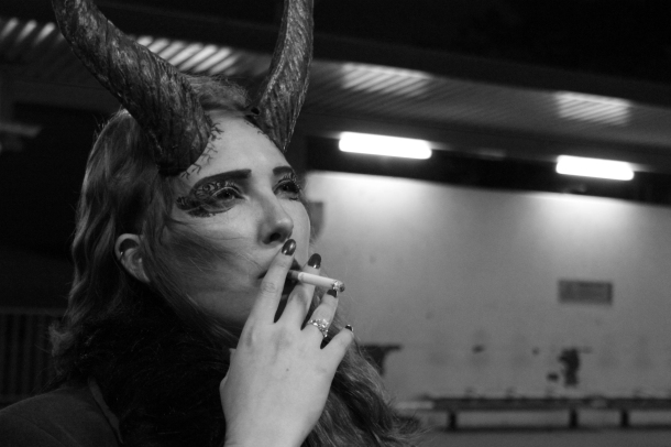 My lovely friend in her glamorous demoness getup, smoking while waiting for the metro. She just looked so fantastic!