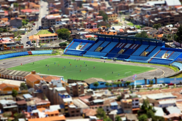 Close up of the soccer stadium in Cajamarca, Peru, with players practicing.