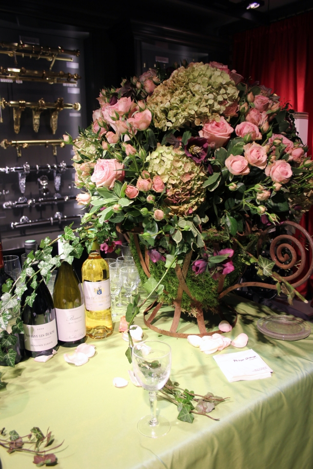 A table setup at the fancy party. Massive flower bouquets and free foie gras, tartlets, and alcohol. And juice for the kids.