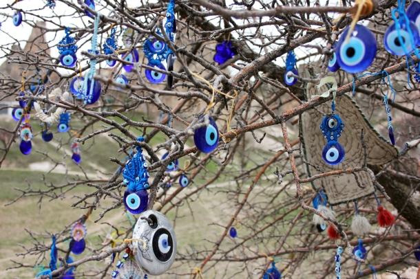 Nazar: The evil eye talisman common throughout the Middle East (but particularly heavy in Turkey) made to protect you from just that. My friends and I discovered a tree FULL of these things swinging in the winds.