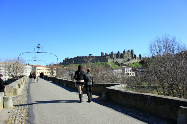 Crossing the Pont Vieux into the old part of Carcassonne, with the castle looming ahead.