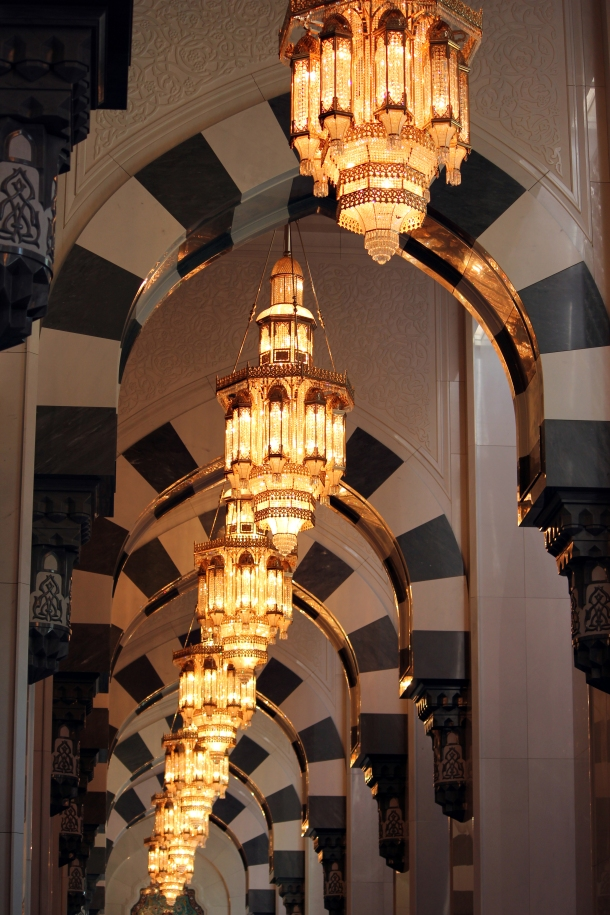 Rows of chandeliers adorn the ceiling of the men's prayer room.