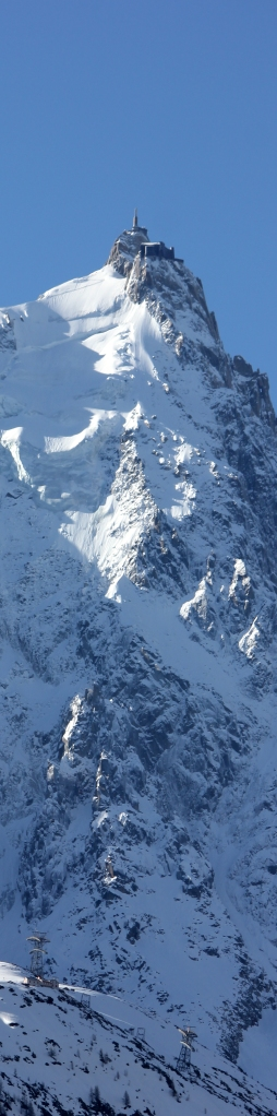This is the Aiguille du Midi--at the tip tip top of this peak is a building where one can stand in a glass box over nothingness, start skiing a massive tour down the valley that takes hours, mail a letter at the highest altitude possible in France, and take in some breathtaking views.