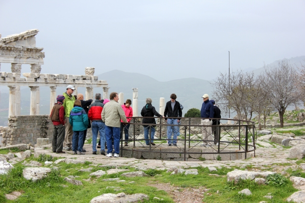 My tour group staring down into the well that was constructed at the top of the mountain. Engineering, yo.