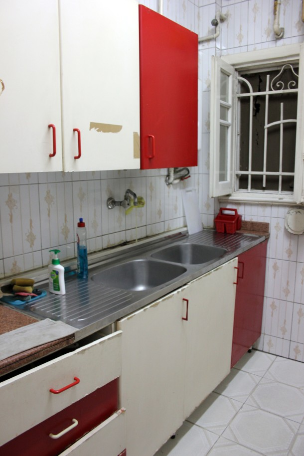 Kitchen shot #2--this is what I mean about a lack of renovation, but it all functions well enough. Minus hot water.