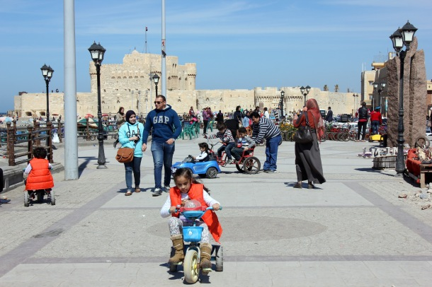 For Qaitbay in the background, one of ten million children enjoying the weekend up front.